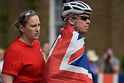 Local spectators await the passing of the peloton.on the first day of competition of the London 2012 Olympic 250km mens' road race. Starting from central London and passing the capital's famous landmarks before heading out into rural England to the gruelling Box Hill in the county of Surrey. Local southwest Londoners lined the route hoping for British favourite Mark Cavendish to win Team GB first medal but were eventually disappointed when Kazakhstan's Alexandre Vinokourov eventually won gold.