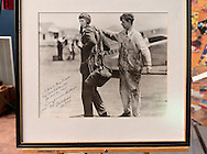 """Erik Lindbergh, grandson of aviator Charles Lindbergh, participates in 85th anniversary celebration of his grandfather's historic solo flight across Atlantic, on Saturday May 19, 2012, at Cradle of Aviation museum, Long Island, New York. Autographed photo of Lindbergh, taken while he was readying for that flight, has dedication: """"George C. Dade, President of Long Island Early Fliers Club, Glen Head, Long Island. in memory of a reunion after 50 years, 1973."""" Significance of the 1927 flight of C. Lindbergh's Spirit of St. Louis which started at nearby Roosevelt Field, and ended at Le Bourget, France - was discussed, along with future of aviation, by panelists Larry Williams, Erik Lindbergh, Martha King and John King; plus, plaque commemorating the flight was rededicated. 10th anniversary of Cradle of Aviation opening and 35th anniversary of Charles A & Anne Morrow Lindbergh Foundation were also celebrated."""