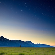 Stars begin to emerge as the sun fades into night in Grand Teton National Park, Wyoming.