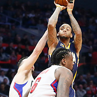 04 December 2016: Indiana Pacers guard Monta Ellis (11) takes a jump shot over LA Clippers guard J.J. Redick (4) and LA Clippers center DeAndre Jordan (6) during the Indiana Pacers 111-102 victory over the LA Clippers, at the Staples Center, Los Angeles, California, USA.