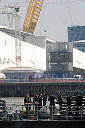 © Licensed to London News Pictures. 15/05/2014. Workers at Canary Wharf were surprised to see a flotilla of Germany Navy vessels appear outside their offices today. The port visit to London by the German Navy includes two mine sweepers (Siegburg and Auerbach), four remotely controlled drone ships, a refueling ship and more. The vessels will remain at West India Dock for the weekend. Crew members on deck as they pass the O2. Credit : Rob Powell/LNP