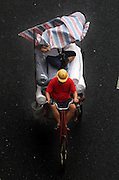 GUANGZHOU, CHINA - JUNE 04: (CHINA OUT) <br /> <br /> Life On The Tricycle<br /> <br /> A porter rides a tricycle carrying cloths and people at Guangzhou International Textile City on June 3, 2014 in Guangzhou, Guangdong Province of China. More than 1,500 tricycles are active in the business district.<br /> ©Exclusivepix