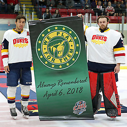 WELLINGTON, ON - SEPTEMBER 14: Andrew Rinaldi #15 of the Wellington Dukes and Olivier Lafreniere #30 of the Wellington Dukes participates in special pregame ceremonies on September 14, 2018 at Wellington and District Community Centre in Wellington, Ontario, Canada.<br /> (Photo by Ed McPherson / OJHL Images)