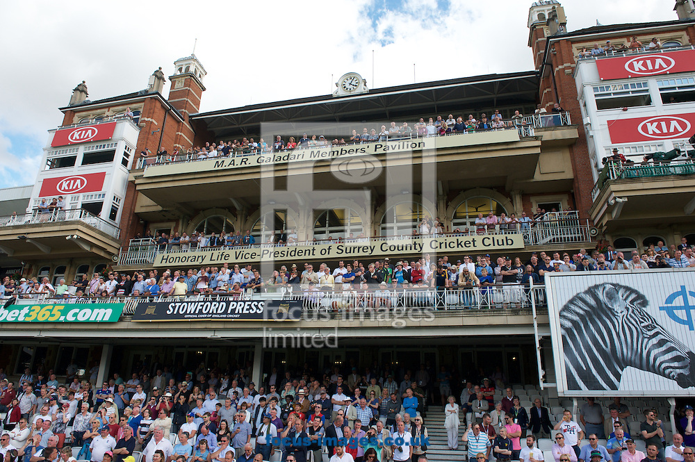 Large crowds in the pavilion watch as  England are presented with the Ashe Trophy during the 5th Investec Ashes Test match at the Kia Oval, London<br /> Picture by Alan Stanford/Focus Images Ltd +44 7915 056117<br /> 23/08/2015