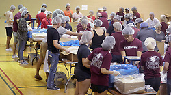 Volunteers pack food during a day of service at Pine Trails Park in Parkland, Fla. on Thursday, February 14, 2019, commemorating the 17 victims killed last year at Marjory Stoneman Douglas High School. Photo by Mike Stocker/Sun Sentinel/TNS/ABACAPRESS.COM