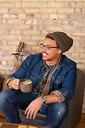 Male with coffee happy at the Yellow Brick Cafe down town Twin Falls, Idaho.