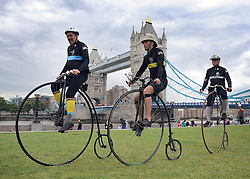 © licensed to London News Pictures. LONDON, UK.  09/06/11. Photo call on Potters field on the South Bank of the Thames with penny farthing riders arriving in London for Saturday's IG Markets London Nocturne cycling event. The riders will all be competing for the Brooks Ordinary trophy, the penny farthing race in Saturday's Nocturne series. Photo credit should read Stephen Simpson/LNP