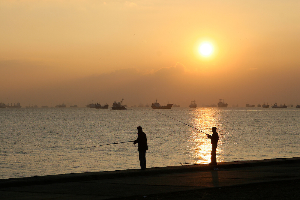 Fishing at sunset looking out over the port of Istanbul.Istanbul, Turkey, 2007