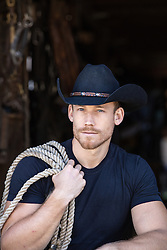 rugged cowboy with rope