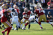 San Francisco 49ers quarterback Jimmy Garoppolo (10) runs with the ball while Los Angeles Rams inside linebacker Cory Littleton (58) defends during an NFL football game, Sunday, Oct. 13, 2019, in Los Angeles. The 49ers defeated the Rams 20-7. (Dylan Stewart/Image of Sport)