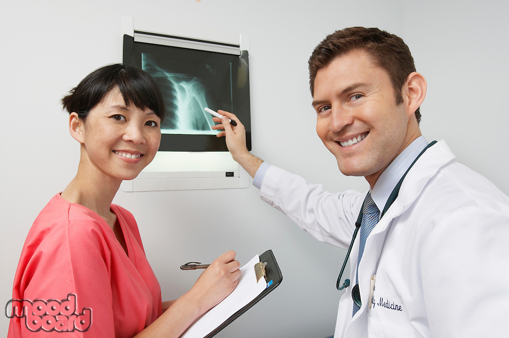 Doctor and nurse examining x-ray in hospital,portrait
