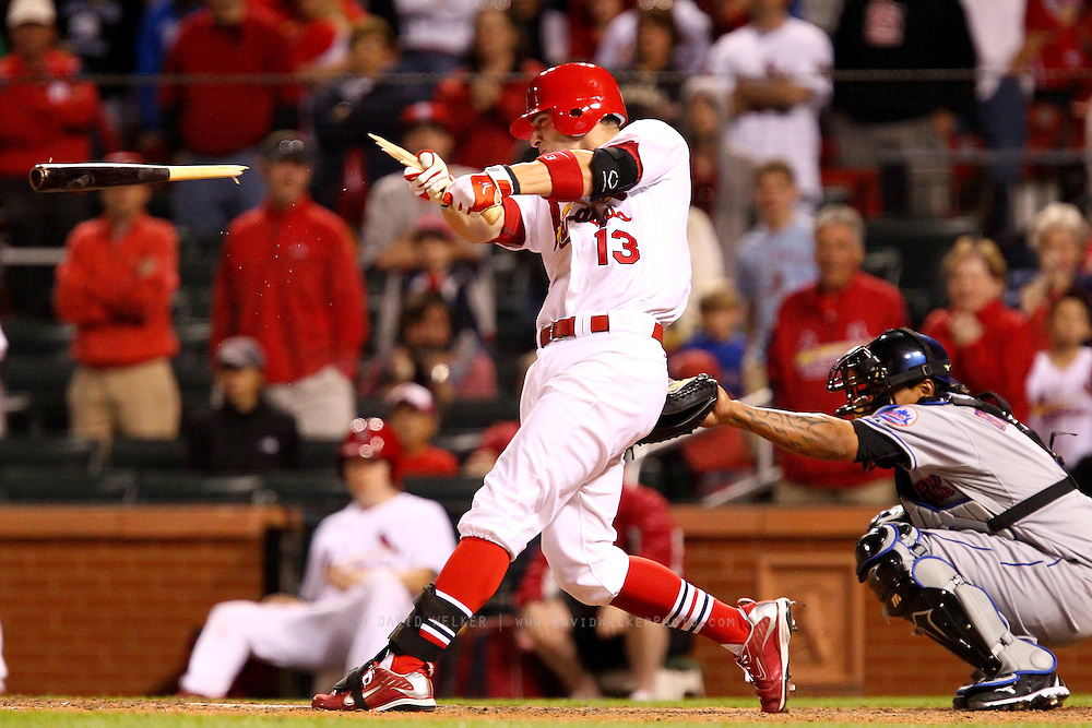 17 April 2010:St. Louis Cardinals shortstop Brendan Ryan (13) breaks his bat during a game against the New York Mets at Busch Stadium in St. Louis, Missouri. The Game would go 20 innings, with the Mets winning 2-1.