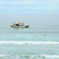 life savers ask pro drill boat to leave surfing contest area at st clair beach