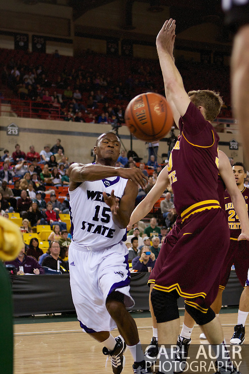November 26th, 2010:  Anchorage, Alaska - Lindsey Hughey (15), a senior guard for Weber State makes a baseline pass in the Wildcats 58-59 loss to Arizona State at the Great Alaska Shootout.