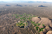 Golf course from the air in Phoenix Arizona. This city of 1,5 million inhabitants is located in the northeastern reaches of the Sonoran Desert. It has the hottest climate of any major city in the United States. The average high temperatures are over 100°F (37.8°C) for three months out of the year, and have spiked over 120°F (48.9°C) on occasion. Phoenix and it's surroundings are home to more than 150 bright green golf courses surrounded by yellow and red desert.
