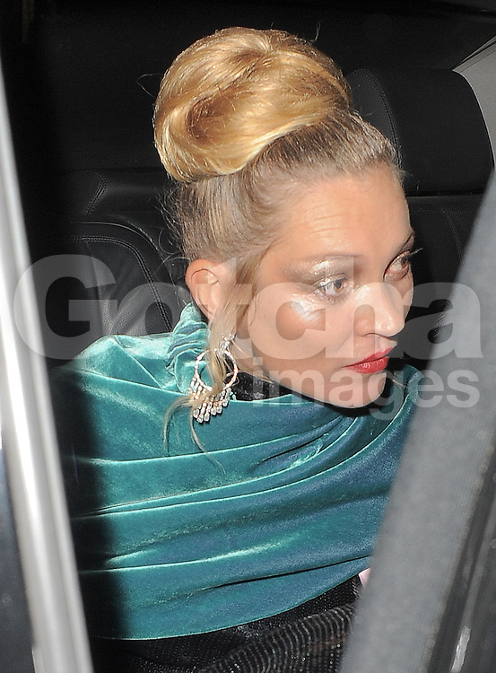 Supermodel Kate Moss leaving Claridges hotel en route to the LFW AnOther Magazine party at Loulou's private members club in Mayfair, London, UK. 15/09/2014<br />