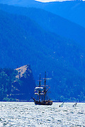 USA, Oregon, Hood River, windsurfers and Lady Washington of the Grays Harbor Historical Seaport Authority.