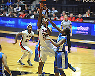 """Ole Miss' Courtney Marbra (25) shoots vs. Kentucky's Brittany Henderson (40) in women's college basketball at the C.M. """"Tad"""" Smith Coliseum in Oxford, Miss. on Thursday, February 28, 2013. Kentucky won 90-65."""