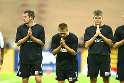 BANGKOK, THAILAND - Wednesday, July 23, 2003: Liverpool's Jamie Carragher (l), Michael Owen (c) and Steven Gerrard (r) bow to the Thai fans before training session in Bangkok, Thailand. (Pic by David Rawcliffe/Propaganda)