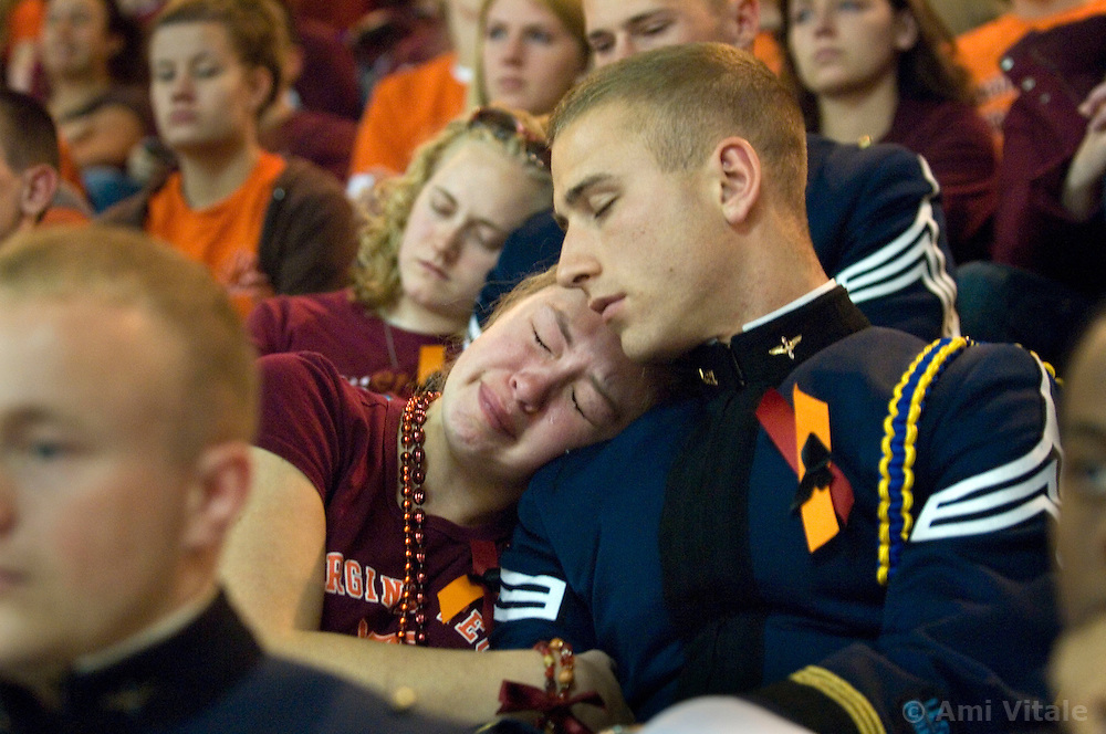 Blacksburg, Va. UNITED STATES: Virginia Tech Cadet Neal Ballas mourns with Jill Weikert during a convocation and memorial April 17, 2007 for victims of the shooting massacre at Virginia Tech University in Blacksburg, Virginia. A 23-year-old student from South Korea was identifiedas the gunman who carried out the deadliest school shooting in US history.  33 people died on Monday, police named the gunman as Cho Seung-Hui, a student at the school and resident alien in the United States. (AMi Vitale)