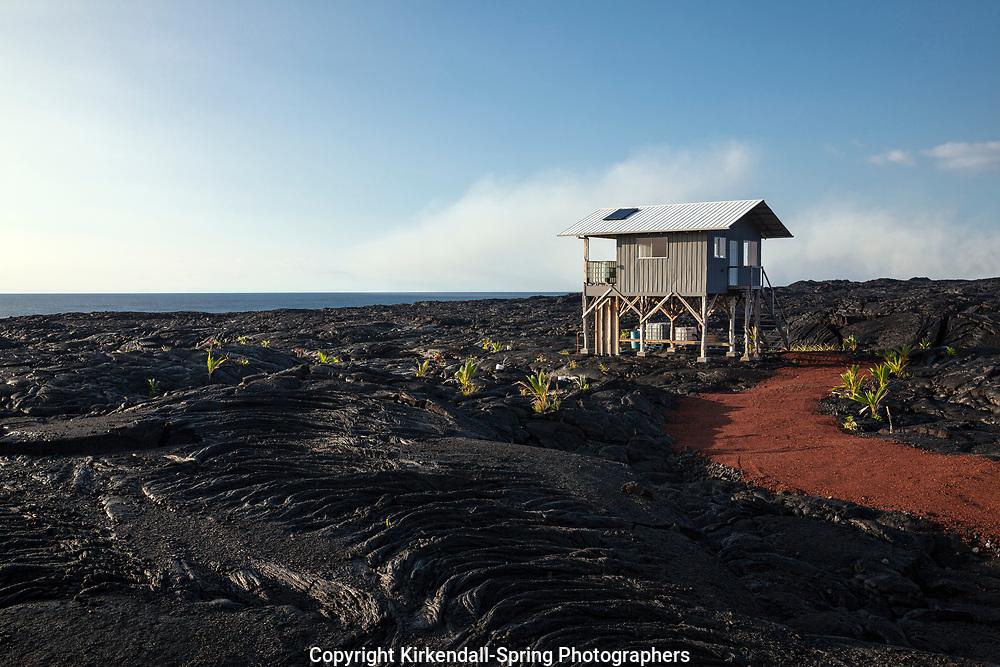 HI00348-00...HAWAI'I - House built in a lava field near the town of Kalapana on the island of Hawai'i.