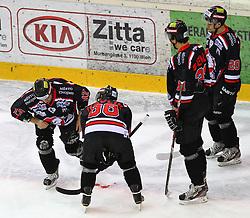 31.01.2012, Albert Schultz Halle, Wien, AUT, EBEL, UPC Vienna Capitals vs HC Orli Znojmo, im Bild Adam Havlik, (HC Orli Znojmo, #88), Jakub Stehlik, (HC Orli Znojmo, #31) und Martin Podesva, (HC Orli Znojmo, #20) bei ihrem verletzten Teamkameraden Radek Haman, (HC Orli Znojmo, #17) // during the icehockey match of EBEL between UPC Vienna Capitals (AUT) and HC Orli Znojmo (CZE) at Albert Schultz Halle, Vienna, Austria on 31/01/2012,  EXPA Pictures © 2012, PhotoCredit: EXPA/ T. Haumer
