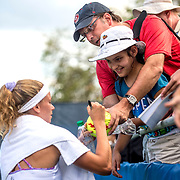 August 20, 2016, New Haven, Connecticut: <br /> Camila Giorgi of Italy signs autographs for fans following a victory during a qualifying match on Day 2 of the 2016 Connecticut Open at the Yale University Tennis Center on Saturday, August  20, 2016 in New Haven, Connecticut. <br /> (Photo by Billie Weiss/Connecticut Open)