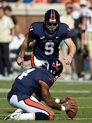 Virginia kicker Chris Gould (9) lines up to kick a field goal with Virginia cornerback Vic Hall (4) as the place holder.  The #23 Virginia Cavaliers defeated the #24 Wake Forest Demon Deacons 17-16 at Scott Stadium in Charlottesville, VA on November 3, 2007.