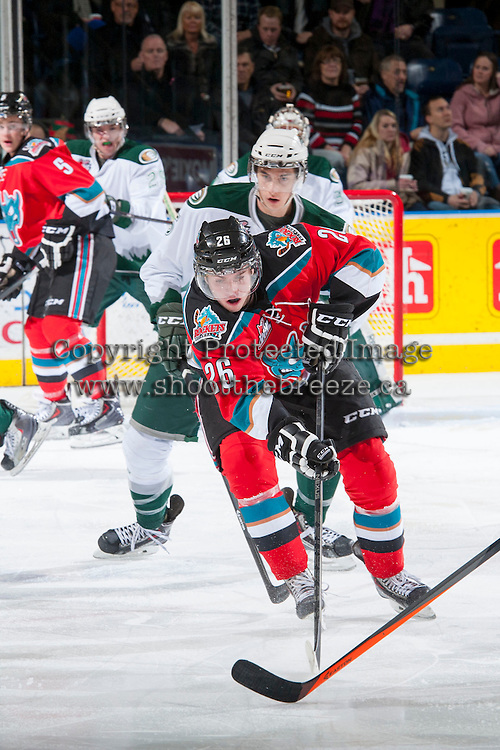 KELOWNA, CANADA - DECEMBER 6: Cole Linaker #26 of the Kelowna Rockets handles the puck against the Everett Silvertips on December 6, 2013 at Prospera Place in Kelowna, British Columbia, Canada.   (Photo by Marissa Baecker/Shoot the Breeze)  ***  Local Caption  ***