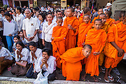 "03 FEBRUARY 2013 - PHNOM PENH, CAMBODIA:  People and novice Buddhist monks pray during the final Buddhist chanting service for former Cambodian King Norodom Sihanouk in the crematorium built for the King's funeral at the National Museum in Phnom Penh. Norodom Sihanouk (31 October 1922 - 15 October 2012) was the King of Cambodia from 1941 to 1955 and again from 1993 to 2004. He was the effective ruler of Cambodia from 1953 to 1970. After his second abdication in 2004, he was given the honorific of ""The King-Father of Cambodia."" He served as puppet head of state for the Khmer Rouge government in 1975-1976, before going into exile. Sihanouk's actual period of effective rule over Cambodia was from 9 November 1953, when Cambodia gained its independence from France, until 18 March 1970, when General Lon Nol and the National Assembly deposed him. Upon his final abdication in 2004, the Cambodian throne council appointed Norodom Sihamoni, one of Sihanouk's sons, as the new king. Sihanouk died in Beijing, China, where he was receiving medical care, on Oct. 15, 2012. His cremation will take place on Feb. 4, 2013. Over a million people are expected to attend the service.    PHOTO BY JACK KURTZ"