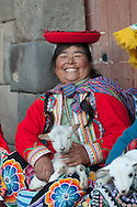 "They call them ""llamitas"" because often bring with them a lama, but you can more easily see with a lamb in her arms. Dressed in their traditional clothes, that in their villages of origin are the dress of everydays, this ladies have realized that you can earn from the pictures. As the local models are proposed to pose with or without tourists, the price is ""on voluntad"" but always a little angry' when the will is only a couple of nuevo soles (60 cents)"