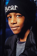 Black teenager with Bear inscribed beanie/hat, Croatia, 1997.