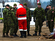Santa Clause hands out goodies to members of the Canadian Armed Forces. The CP Holiday Train stopped in Revelstoke on Dec. 14, 2017. Alan Doyle and The Beautiful band performed and Community Connections Food Bank received $10K. (Marissa Tiel/ Revelstoke Review)