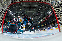 KELOWNA, CANADA - DECEMBER 1:  Eric Florchuk #17 of the Saskatoon Blades is checked by Devin Steffler #4 as Roman Basran #30 of the Kelowna Rockets makes the save on December 1, 2018 at Prospera Place in Kelowna, British Columbia, Canada.  (Photo by Marissa Baecker/Shoot the Breeze)