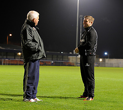 Weston Super Mare Manager, Micky Bell talks with Weston super mare Grounds man Bob Flaskett prior to kick off. - Photo mandatory by-line: Alex James/JMP - Mobile: 07966 386802 - 18/11/2014 - SPORT - Football - Weston-super-Mare - Woodspring Stadium - Weston-super-Mare v Doncaster - FA Cup - Round One