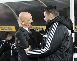 Watford Manager, Giuseppe Sannino and Bristol City manager, Steve Cotterill share a joke before the game - Photo mandatory by-line: Dougie Allward/JMP - Tel: Mobile: 07966 386802 14/01/2014 - SPORT - FOOTBALL - Vicarage Road - Watford - Watford v Bristol City - FA Cup - Third Round - replay