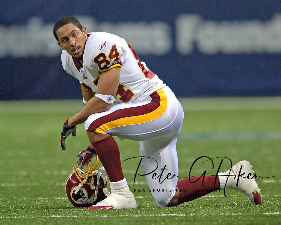Washington Redskins wide receiver Taylor Jacobs takes a brake during a injury time-out in the first half, at the Edward Jones Dome in St. Louis, Missouri, December 4, 2005.  The Redskins beat the Rams 24-9.