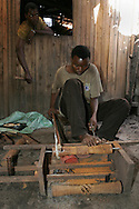 A woodcarver at the Mwenge craft cooperative in Dar es Salaam, Tanzania.