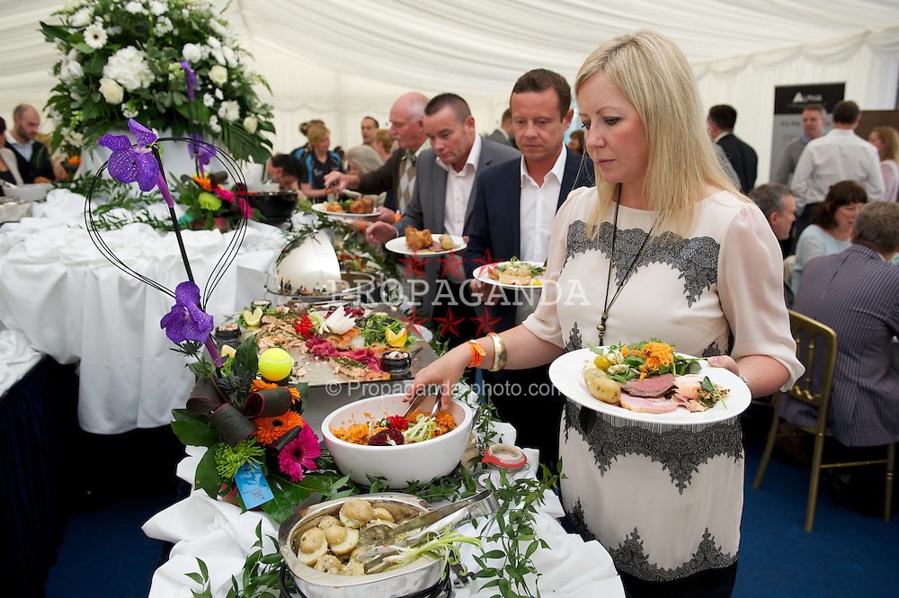 LIVERPOOL, ENGLAND - Thursday, June 21, 2012: Lunch is served in the corporate tent during the opening day of the Medicash Liverpool International Tennis Tournament at Calderstones Park. (Pic by David Rawcliffe/Propaganda)