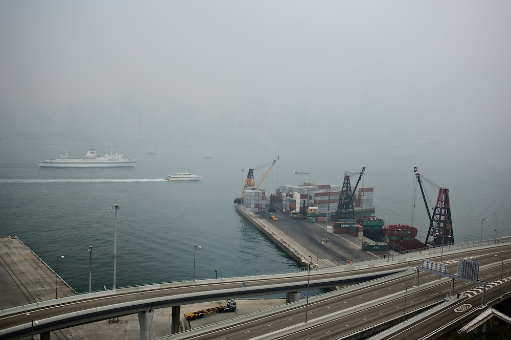 Container pier and foggy Victoria Harbour, Kowloon, Hong Kong