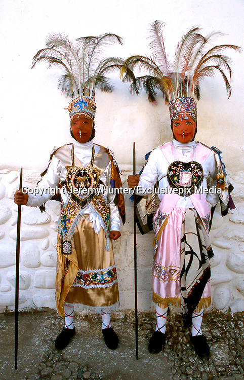 Amazing costumes of the Pagan-Christian festival <br /> <br /> In Peru, every July,  Paucartambo, a remote white-washed town, nestling at 10,000 feet up in the Andes, hosts one of the biggest festivals in South America.<br /> <br /> This Pagan-Christian festival celebrates The Earth Mother, Patron Saint of the Mestizo, a half-caste group - part European, part AmerIndian -  who reached Paucartamo during the 17th century.<br /> <br /> For three days, The Earth Mother is carried around the town, protected by rival mythical birds and animals who scale the roof-tops enacting a story of  struggles and miracles.<br /> Many of these wear feathered head-dresses for during the 17th century feathers were considered more valuable than gold. it's a wild, noisy and drunken celebration!<br /> <br /> Mythical birds and animals enact a story of struggles and miracles<br /> Paucartambo Festival, Peru<br /> ©JeremyHunter/Exclusivepix Media