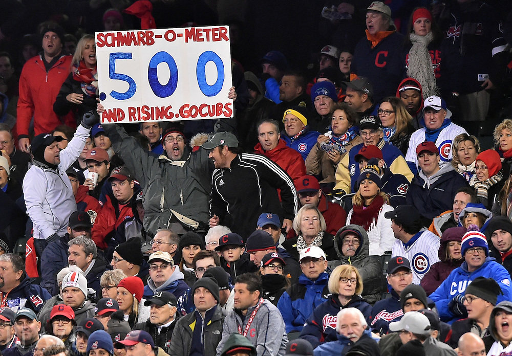 Oct 26, 2016; Cleveland, OH, USA; Chicago Cubs fans hold up a sign for player Kyle Schwarber (not pictured) in the third inning against the Cleveland Indians in game two of the 2016 World Series at Progressive Field. Mandatory Credit: Ken Blaze-USA TODAY Sports