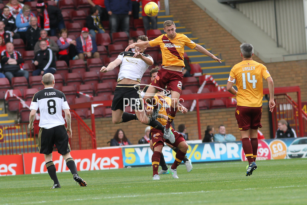 Close Challenge between Louis Moult and Ash Taylor during the Ladbrokes Scottish Premiership match between Motherwell and Aberdeen at Fir Park, Motherwell, Scotland on 15 August 2015. Photo by Craig McAllister.