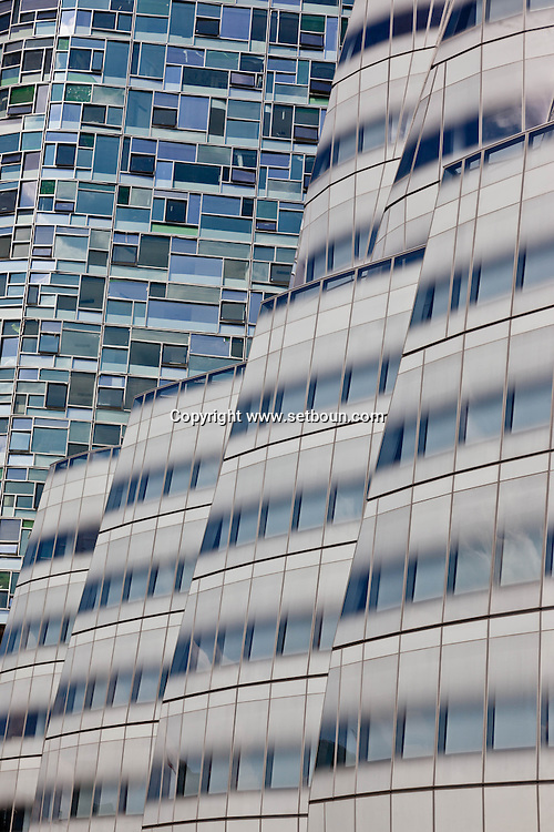 New York , Chelsea district. jean nouvel building and in front Frank Gehry s design for InterActiveCorp s New York headquarters, built on the West Side Highway near the Chelsea Piers complex.Ship of Glass for Chelsea Waterfront  New York - United states  Manhattan