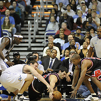 19 December 2007:   Washington Wizards forward Darius Songaila (L) scrambles for a loose ball in the second half with Chicago Bulls guard Kirk Hinrich (C) and guard Chris Duhon (R) at the Verizon Center in Washington, D.C.  The Bulls defeated the Wizards 95-84.