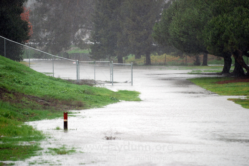 Flood waters from Tuesday's storms pool near the 101 freeway and Casentini St. in Salinas.