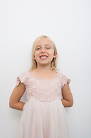 Portrait of girl smiling against white background