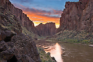 Upper Owyhee River. Sunset reflecting on water with canyon walls.