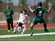 Evie Pena (6) of Hockaday School crosses the ball past Torri Mayden (8) of Greenhill during the SPC Division I girls soccer championship game at Episcopal School of Dallas on Saturday, February 16, 2013 in Dallas, Texas. (Cooper Neill/The Dallas Morning News)