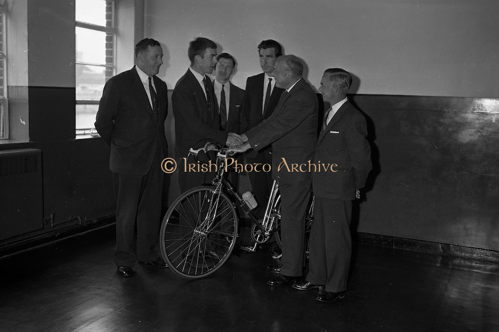 Seamus O'Hanlon, winner of Rás Tailteann, the annual eight day international cycling stage race.<br /> 1962. 14.08.1962. 08.14.1962. 14th August 1962.<br /> A presentation of a Raleigh 'Gran Sport' bicycle complete with Capagnolo 10 speed gear system was made to Seamus O'Hanlon, a twenty-year-old Dubliner, who won the Rás Tailteann this year. The presentation was made as he toured the Irish Raleigh Industries factory at Hanover Quay, Dublin.<br /> Picture shows (from left), Mr Thomas McGovern, General Sales Manager, Components; Mr Seamus O'Hanlon, Rás Tailteann Winner; Mr Harry Doherty, Sales Manager; Mr Joe Christle, Race Director, Rás Tailteann; Mr Desmond Beatty, Managing Director, Irish Raleigh and Mr WH Charlesworth, Works Director, taking part in the presentation.
